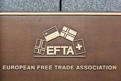 在墙壁上的欧洲自由贸易联盟标志 免版税库存照片