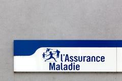 在墙壁上的法国社会保险标志 免版税库存图片