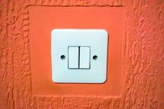 在墙壁上的电开关 免版税库存图片