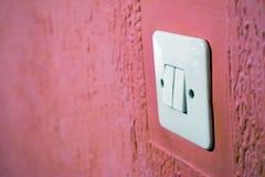 在墙壁上的电开关 库存图片