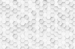 在墙壁上的白色几何六角形arrang 免版税库存图片