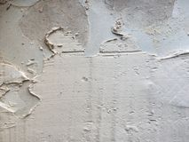 在墙壁上的盖瓦胶粘剂 库存图片