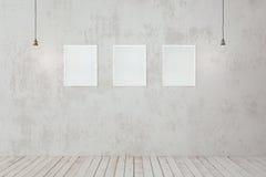 在墙壁上的空白的照片框架 免版税库存图片