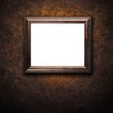 在墙壁上的老古色古香的框架 免版税库存照片