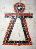 在墙壁上的老妇人马赛克 免版税库存图片