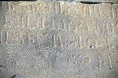 在墙壁上的老文字在亚美尼亚语 免版税图库摄影