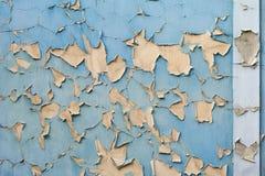 在墙壁上的老蓝色和黄色纹理 免版税库存照片