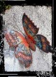 在墙壁上的色的蝴蝶 免版税库存照片