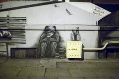 在墙壁上的街道画。 免版税库存图片