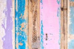 在墙壁上的被绘的土气搭乘,纹理材料 免版税库存照片