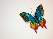 在墙壁上的装饰蝴蝶 免版税库存图片
