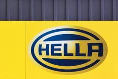 在墙壁上的Hella商标 免版税库存图片
