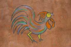 在墙壁上绘的雄鸡 免版税库存照片