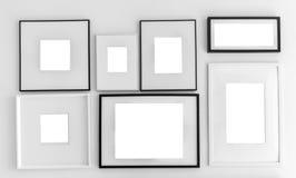 在墙壁上设置的空白的画框模板 库存图片