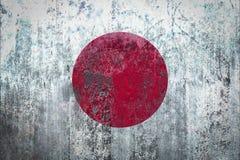 在墙壁上绘的日本旗子 免版税库存照片