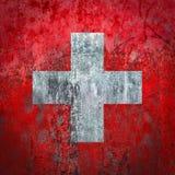 在墙壁上绘的瑞士旗子 库存照片