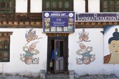 在墙壁上画的生育力的标志在不丹 免版税图库摄影