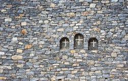 在墙壁的十字架 免版税库存照片
