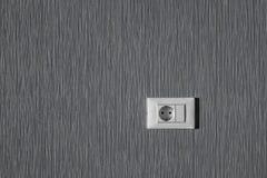 在墙壁的电源插座 免版税库存照片