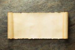 在墙壁的羊皮纸纸卷 库存图片