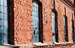 在墙壁的老大块玻璃 图库摄影