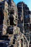 在墙壁的被雕刻的面孔在吴哥窟 免版税图库摄影