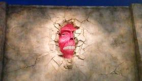 在墙壁的面孔 库存照片