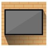 在墙壁砖的电视 图库摄影