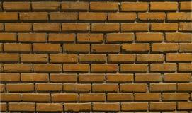 在墙壁背景的橙色颜色砖 库存照片