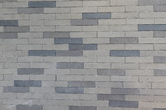 在墙壁背景的灰色颜色砖 库存照片