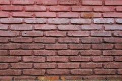 在墙壁背景的独特的砖墙 免版税库存照片