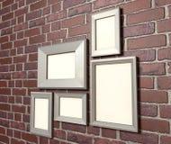 在墙壁透视图的空白画框 免版税库存图片