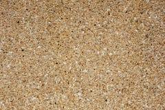 在墙壁,纹理上的硅土沙子 免版税库存照片