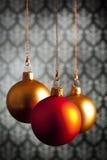 在墙纸背景的三个圣诞节中看不中用的物品 免版税图库摄影