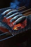 在壁炉的烤鱼 图库摄影
