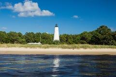 在壳海岛上的灯塔 免版税库存照片