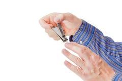 在复式杠杆样式的指甲夹在男性手上 免版税库存照片
