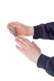 在复式杠杆样式的指甲夹在男性手上 库存照片