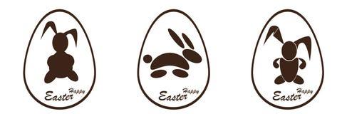 在复活节彩蛋的巧克力兔宝宝 图库摄影