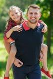 在夏天公园生使用与他的女儿 免版税图库摄影