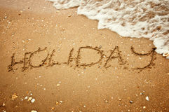 在夏天海滩沙子的假日 免版税图库摄影