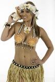在夏威夷服装打扮的俏丽的妇女 免版税图库摄影