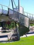 在外部的螺旋形楼梯一走的通过一座高的桥梁 免版税图库摄影