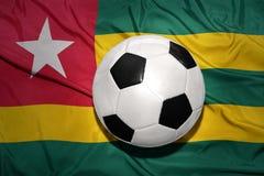 在多哥的国旗的黑白橄榄球球 库存照片