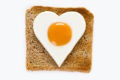 在多士的煮熟的鸡蛋 免版税图库摄影