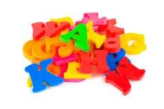 在多彩多姿的玩具上写字 库存图片