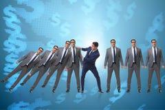 在多米诺作用企业概念的商人 免版税库存图片