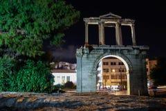 在夜光的古色古香的古老门 免版税图库摄影