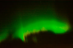 在夜空的北极光 免版税库存照片