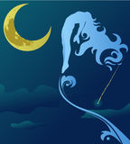 在夜空的妇女飞行 免版税图库摄影